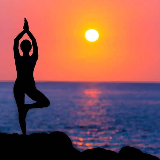 Namaste Silhouette of Woman in Yoga Pose at Beach