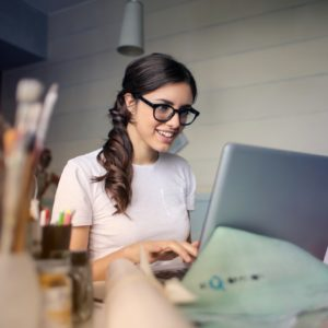 Girl using her computer for Telemental Health Benefits